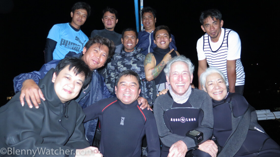 photo of diver, dive guide and boat crew.